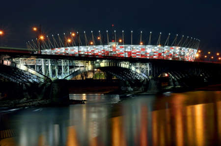 National Stadium behind the bridge. Night view. Vistula river. Hdr image.