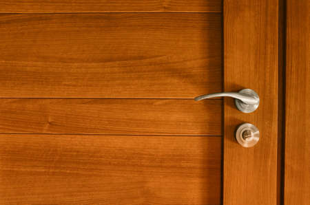 Wooden door with bathroom steel lock and handle Stock Photo - 12539898