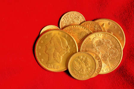 Golden coins from the end of nineteenth century. Rubels, dollars, swiss and french francs.