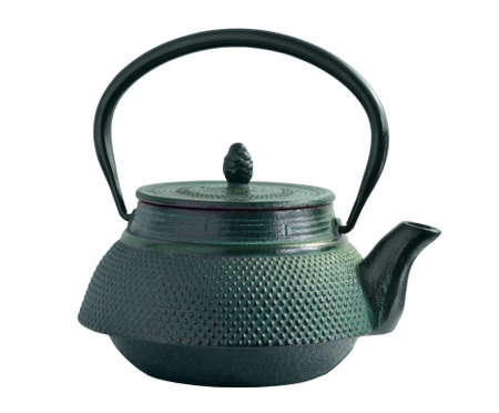 relief: Oriental iron tea pot covered with green paint color. Isolated with path on whitebackground.