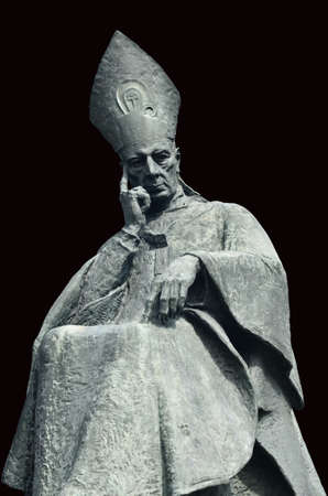 Cardinal bishop Wyszynski bronze monument in Warsaw. Isolated with path on black background. Stock Photo