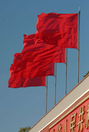 Four red flags from Tienanmen square in Peking. Royal Palace in Forbidden City.