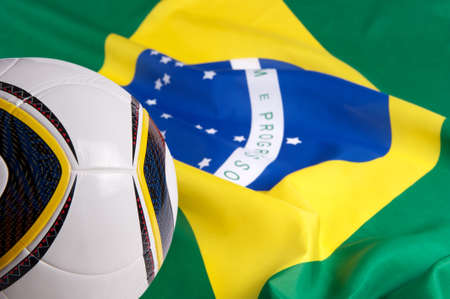 Flag of Brazil and soccer ball photo