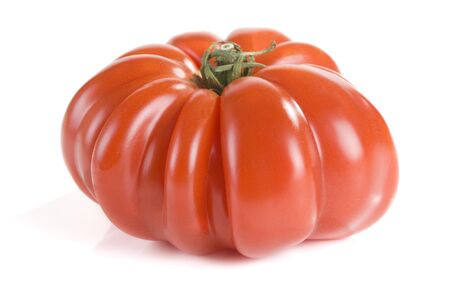 heirloom: Heirloom tomato isolated on a white background