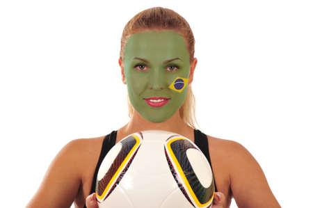 cara pintada: Mundial 2010 - Fan de Brasil con el rostro pintado con bal�n de f�tbol