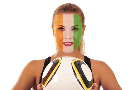 cara pintada: Mundial 2010 - Fan de Costa de Marfil con rostro pintado con el bal�n de f�tbol