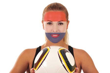cara pintada: Mundial 2010 - Fan de Holanda con el rostro pintado con bal�n de f�tbol