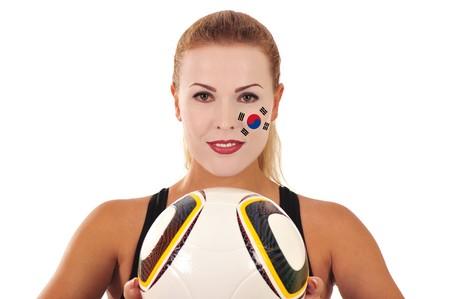 cara pintada: Mundial 2010 - Fan de Corea del norte con el rostro pintado con el bal�n de f�tbol