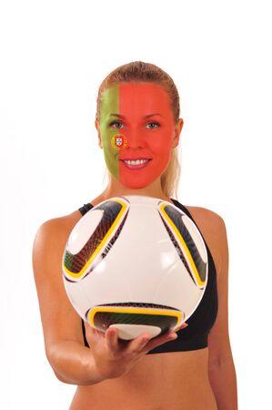 cara pintada: Mundial 2010 - Fan de Portugal con el rostro pintado con bal�n de f�tbol Foto de archivo