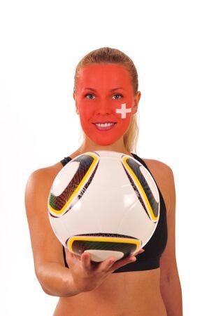cara pintada: Mundial 2010 - Fan de Suiza con el rostro pintado con el bal�n de f�tbol Foto de archivo