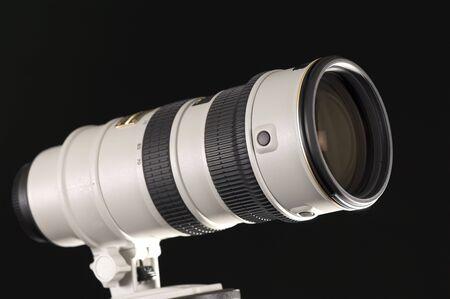 Camera lens isolated on black background Stock Photo - 7354419