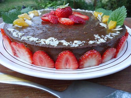Raw vegan carob cake with strawberries