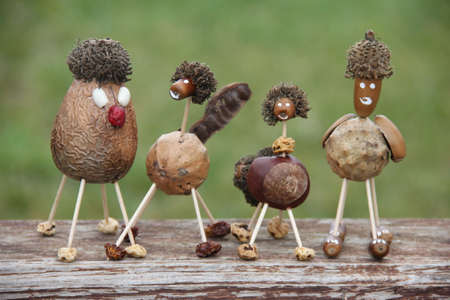 Funny characters hand made of forest nuts and seeds