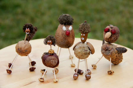 Natural toys made from chestnuts, cones and seeds