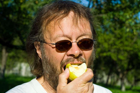 apple eating man photo