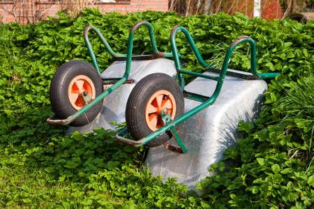 wheelbarrows in a garden Stock Photo - 4964125