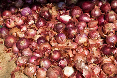 red onions: Red onions on a market