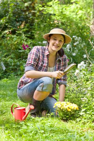 Young woman gardening in a garden photo