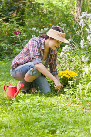spare time: Young woman gardening in a garden