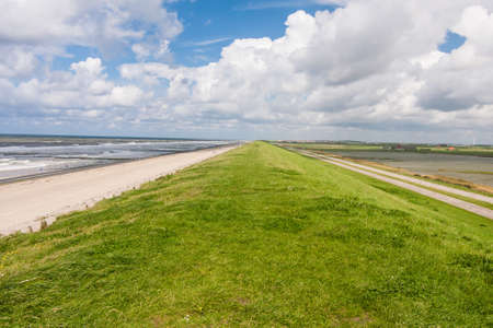 endlessness: Levee at the North Sea in the Netherlands Stock Photo