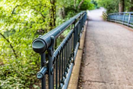 hand rail: metal hand rail of a bridge in a forest