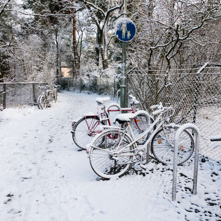 snows: bicycles with snows in winter Stock Photo