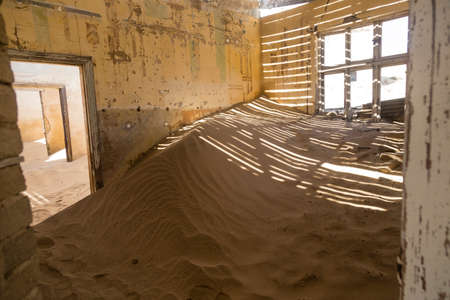 ghost town: abandoned houses in the ghost town Kolmanskop, Namibia