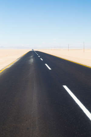 road marking: highway with road marking in the desert