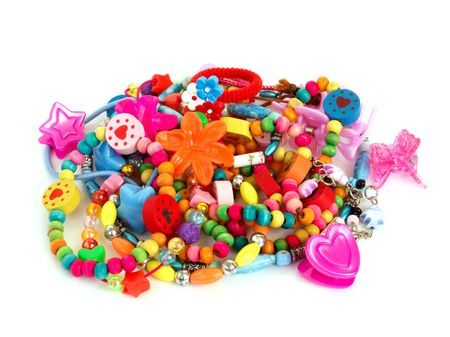 trinket: Childrens colorful trinkets made from plastic, wood, glass and semiprecious gems isolated on white