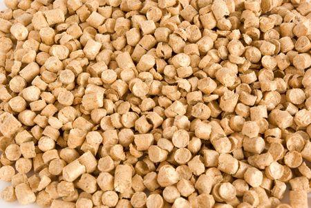 biomasa: Pellets de madera de fondo. Una forma alternativa de producir energ�a. Foto de archivo
