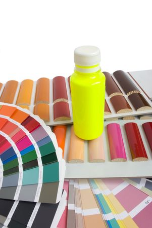 bottle of yellow fluorescent paint on the color catalogs photo
