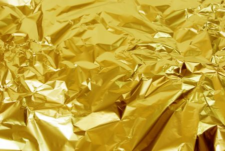 crinkles: photo of abstract golden foil texture