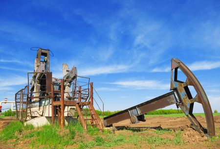 abandoned oil pump jack in field photo