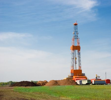 Oil drilling rig on the field Stock Photo