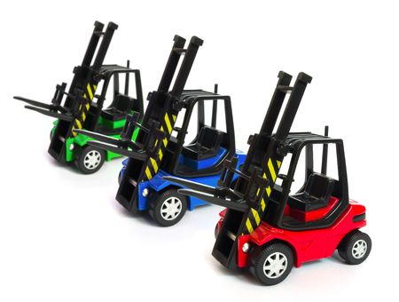 forklifts: toy electric forklifts isolated on white