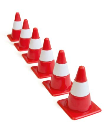 Row of red traffic cones isolated on white Stock Photo - 5221095