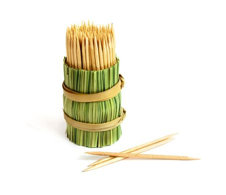 bamboo toothpick containers and three toothpicks photo
