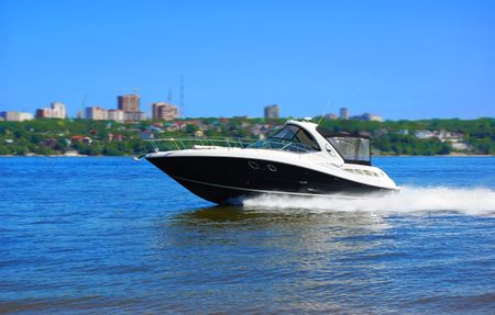 river banks: luxury speed boat on river Stock Photo