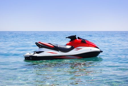 water skiing: Red jet ski in the sea