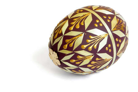 Brown easter  egg decorated golden paint and veneer isolated on white Stock Photo - 5581816