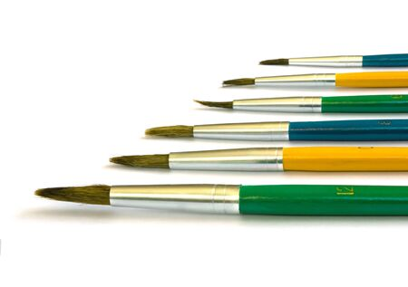 Six colored paintbrushes of the various sizes  isolated on white photo