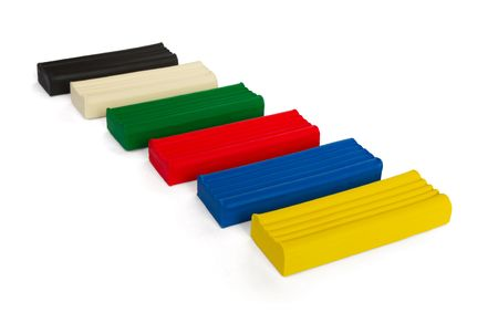 Set of coloured plasticine bricks isolated on white photo