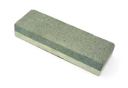 Bilaterial abrasive whetstone isolated on  white photo