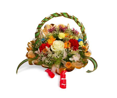 Bouquet of various flowers in a basket isolated on  white photo