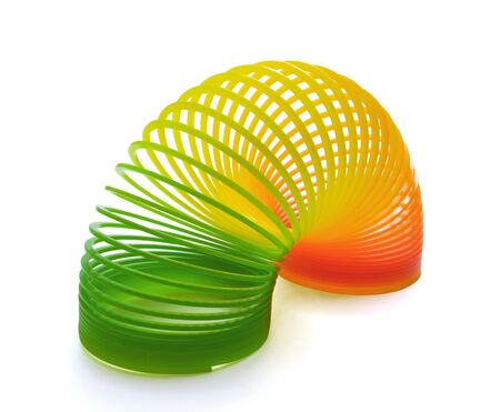 springy: Plastic spring toy isolated on white
