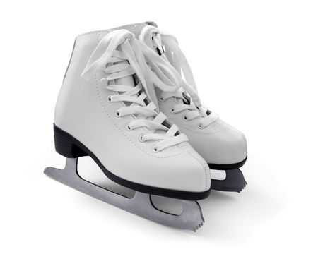 Pair of womens white figure ice skates isolated on white photo