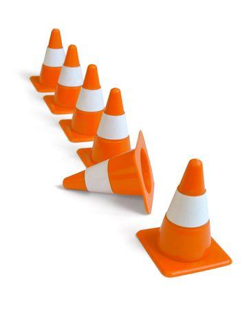 Row of orange plastic traffic cones isolated on white photo