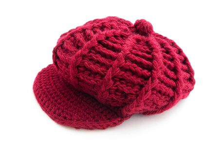 Winter red wool cap isolated on white photo