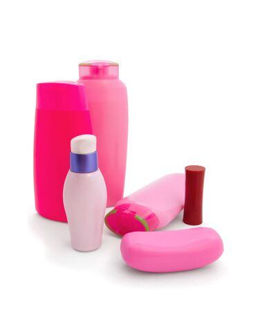Pink cosmetics set isolated on white photo