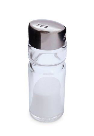 Glass and steel salt shaker with salt isolated on white photo